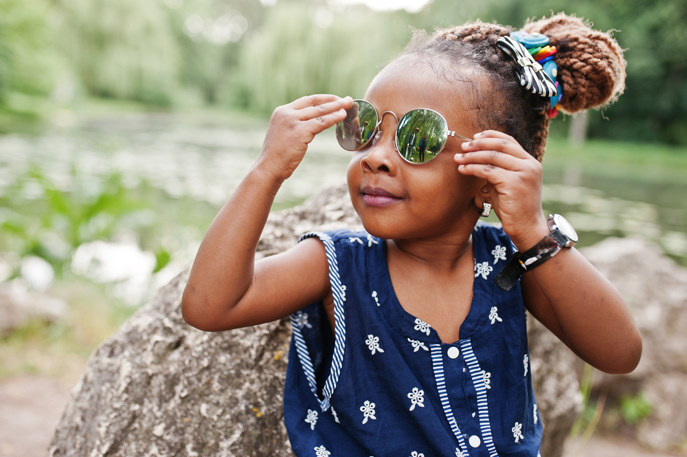 Little girl wearing round sunglasses