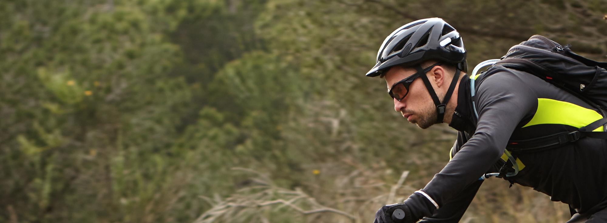 Man mountain biking wearing sunglasses