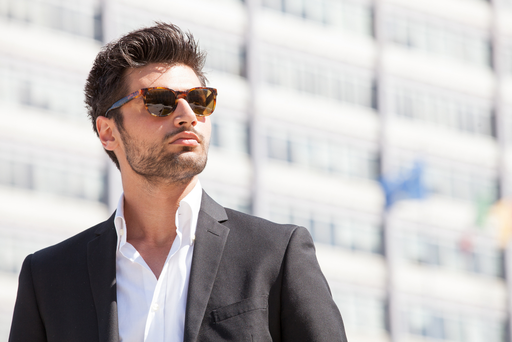 young man in suit wearing sunglasses