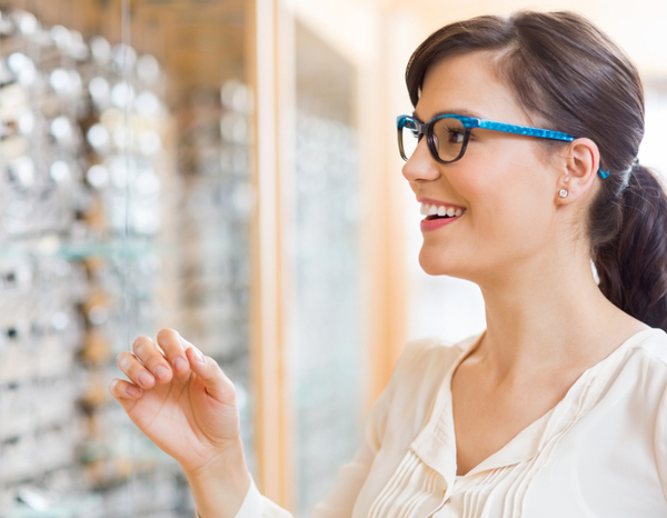 Smiling woman choosing glasses