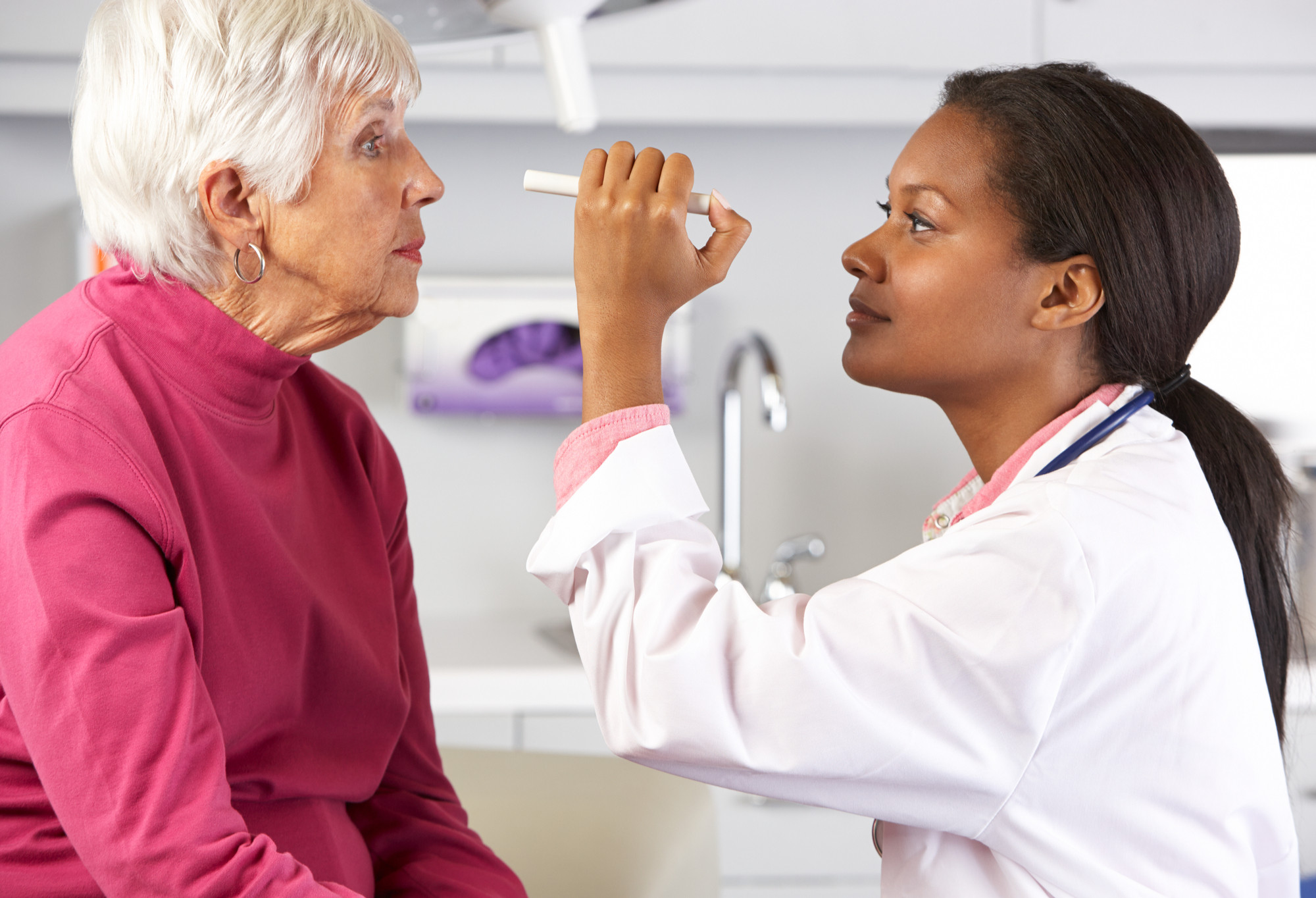 Optometrist examing an eye for common eye conditions